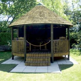 Raised Empire Breeze House with cedar shingle roof