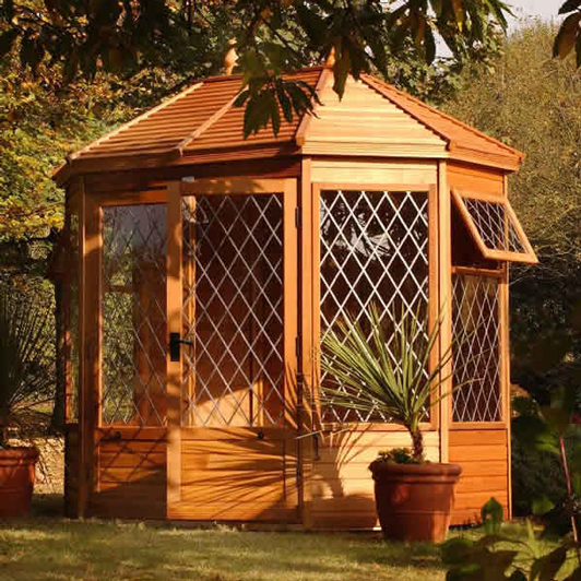 "8'5"" x 6' cedar Gazebo with cedar slatted roof, diamond leaded windows and doors"