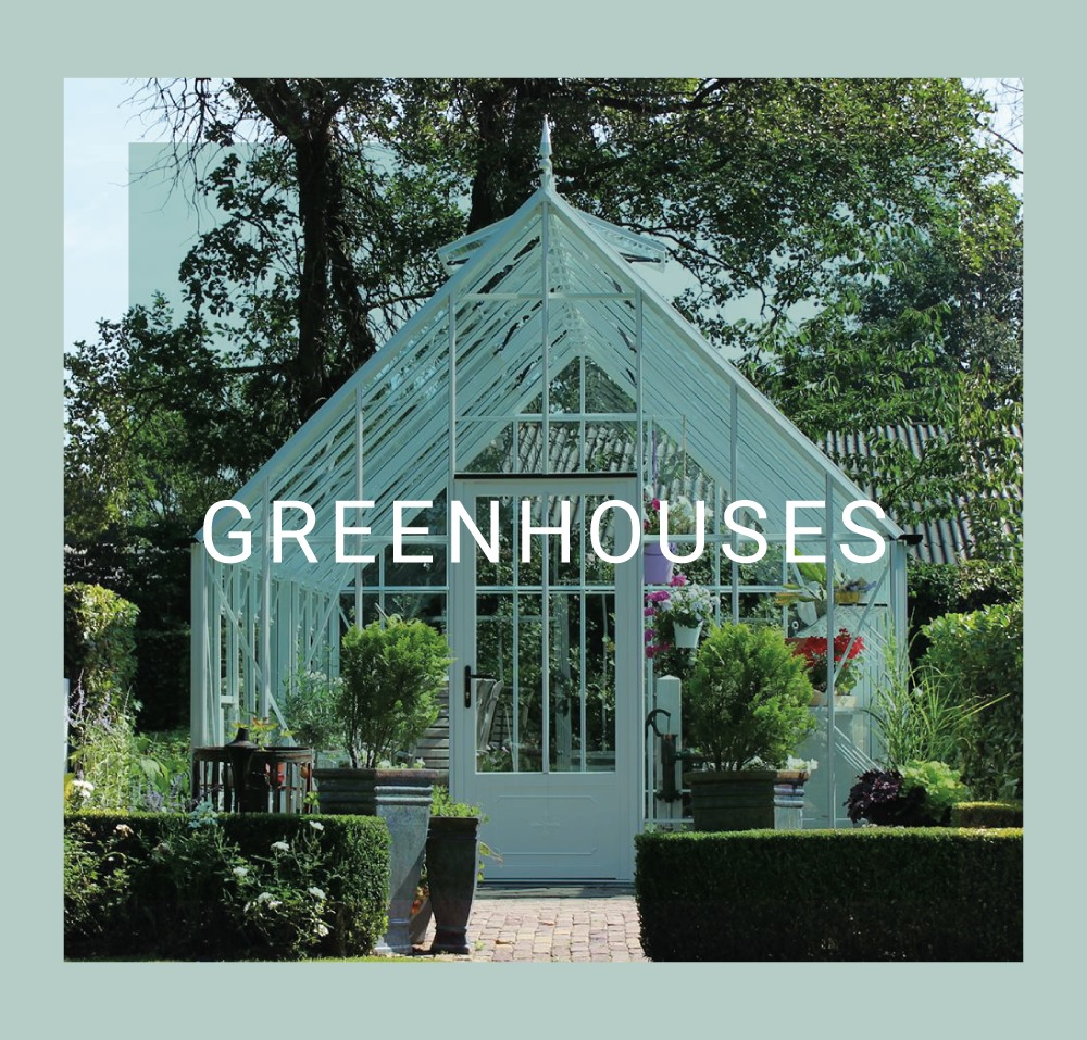 A white green house with a steeped glass roof is centre framed with the word 'greenhouses' overlaid. Surrounding it are plants and shrubs.