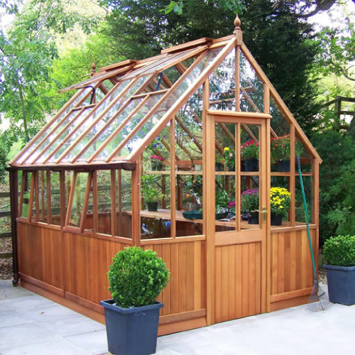 """10'3"""" x 7'9"""" cedar Victorian with staging and shelving"""