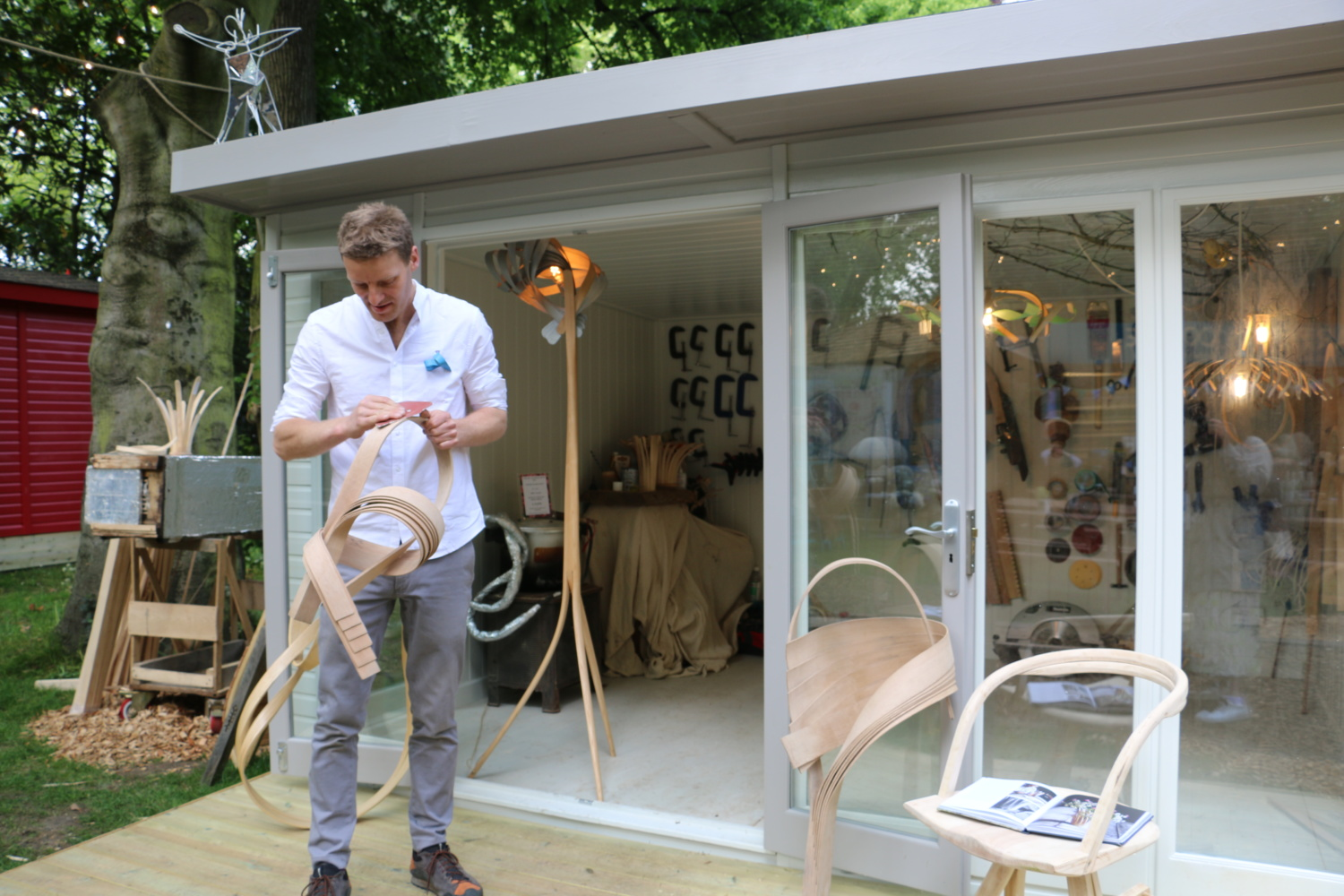 Artisan working outside Studio building at Chelsea Flower Show 2019