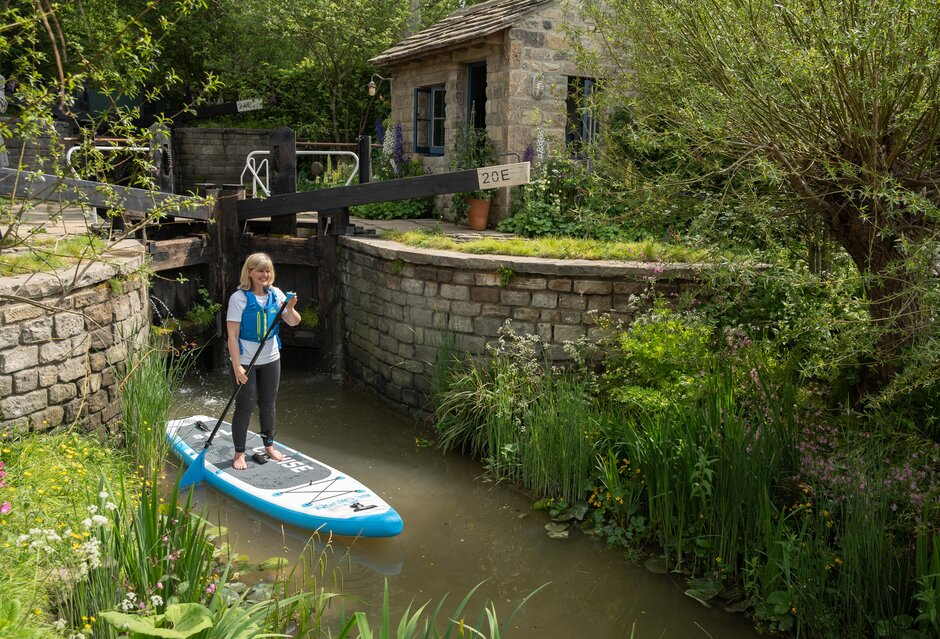 Paddleboarder Jo Mosely poses in The Welcome to Yorkshire show garden at the RHS Chelsea Flower Show during press day in London, May 20, 2019. Photograph by Suzanne Plunkett/RHS