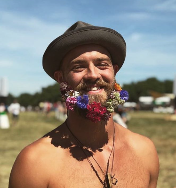 Man at festival with beard bouquet