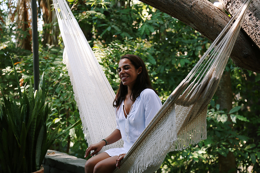 A lady sitting in a hammock