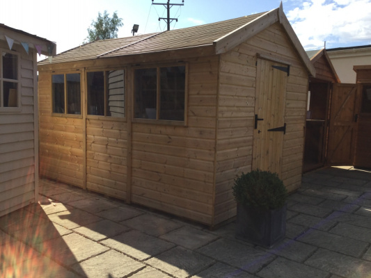 12 x 8 heavy duty timber shed with single door and side windows