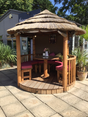 Open sided luxury thatch and timber garden gazebo