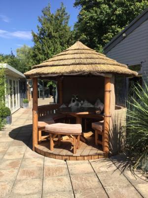 Thatch and timber garden gazebo