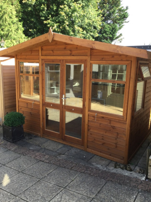 Timber and glazed garden building