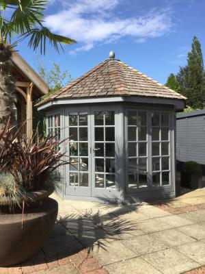 Pale blue painted octagonal glazed summerhouse