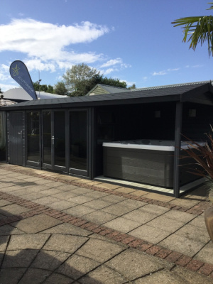Garden building with shed store, studio and open sided deck combined.