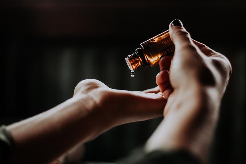Drop of essential oils onto hand