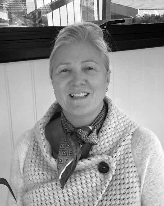 A black and white headshot of Hazel who is smiling. Hazel works as part of our sales team at our Buckinghamshire showsite