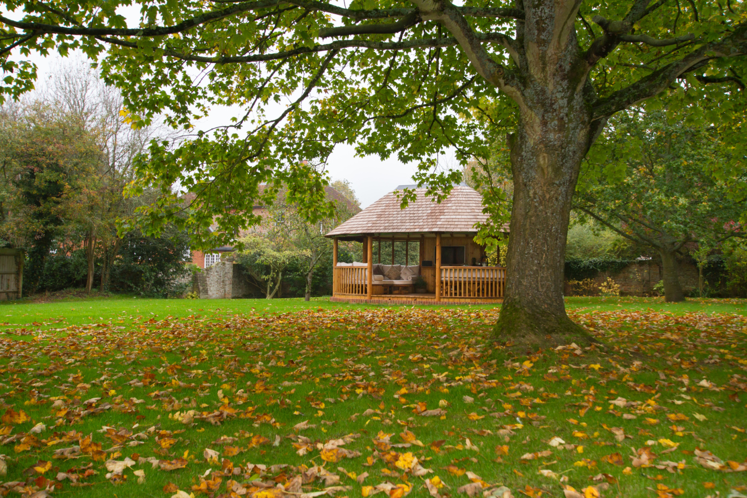 Opensided luxury gazebo in autumn garden