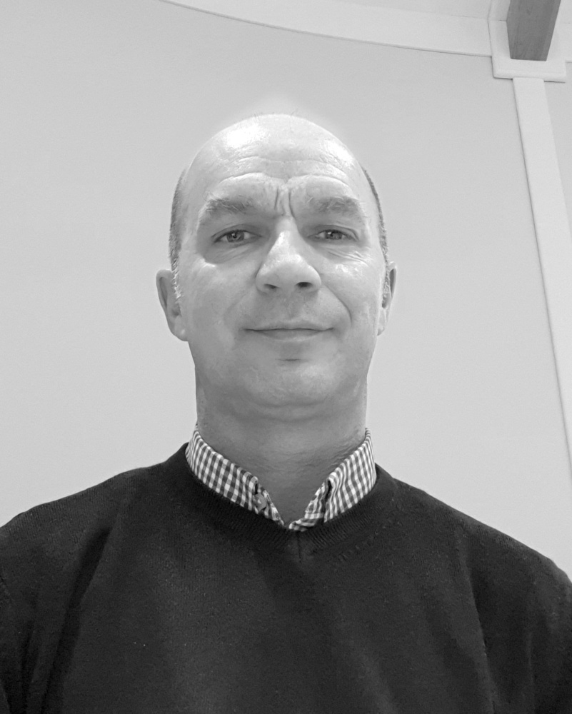 A black and white headshot of Chris who is smiling. Chris works as part of our sales team at our Devon showsite