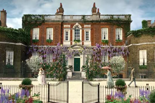 Rangers House in London. A grand Georgian villa used in the Netflix series Bridgerton. The front of the house is adorned with lilac flowering Wisteria that was created for the show.
