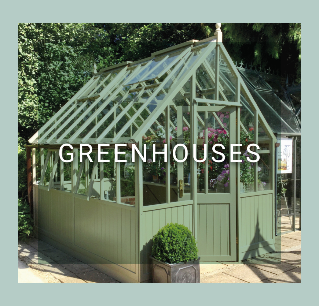 A greenhouse building with a steep glass roof. The word greenhouses is overlaid in the entire of the frame. There are small shrubs in front of the greenhouse.